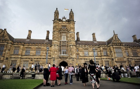 University students walk on the campus of University of Sydney following a graduation ceremony in Sydney